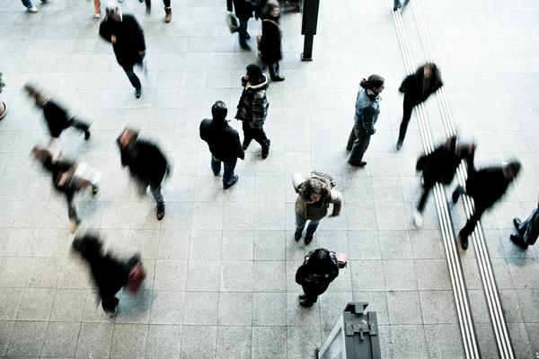 aerial photo of people walking on a platform