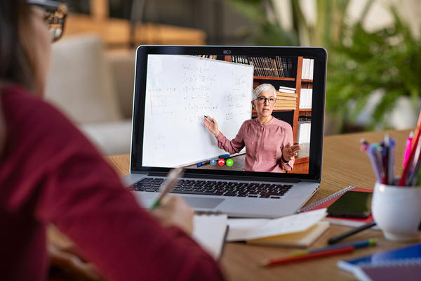 A student watching a tutor as they deliver an online tutorial