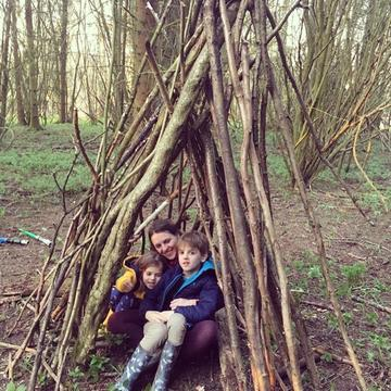 Family in a den in the woods