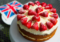 Victoria sponge cake covered in strawberries